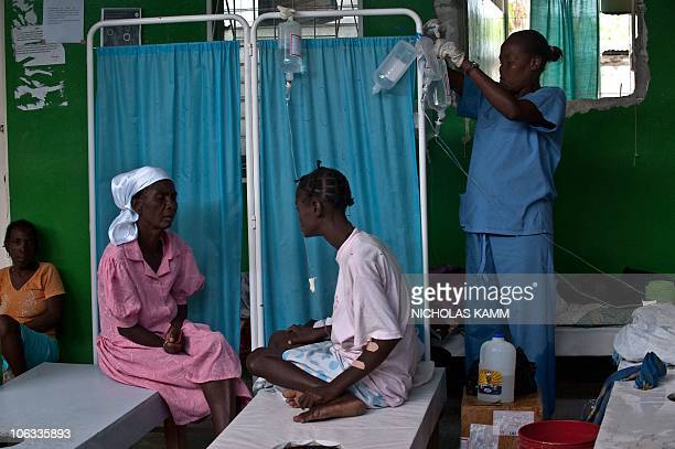 A nurse changes IV drips in a ward of cholera patients at the Charles Colimon hospital in Petite Riviere on the Artibonite river believed to be the...