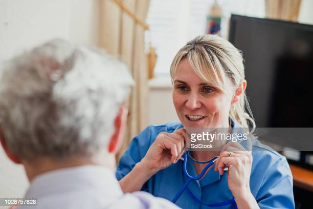 Nurse Checking her Patient's Pulse