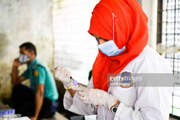 Nurse collects a blood sample to cross-match DNA with victims who died after a fire broke out at a Hashem Foods Ltd factory in Rupganj, Narayanganj...