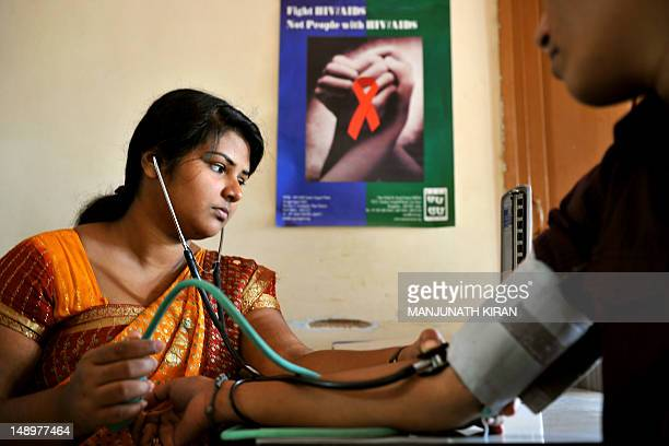 A nurse conducts tests on an HIVpositive patient during a routine medical checkup at the Anti Retroviral Therapy clinic at the Asha Foundation a...
