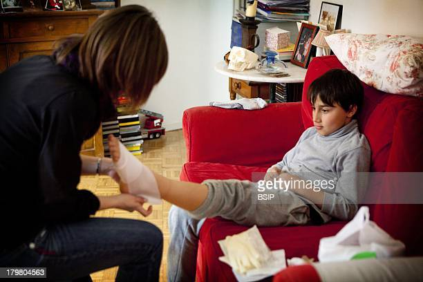 Nurse Dispensing Care Everyday life of an independent nurse Bagnolet France Foot care after a plantar wart removal