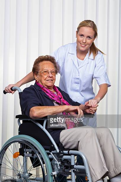 nurse doctor and elder lady in a wheel chair