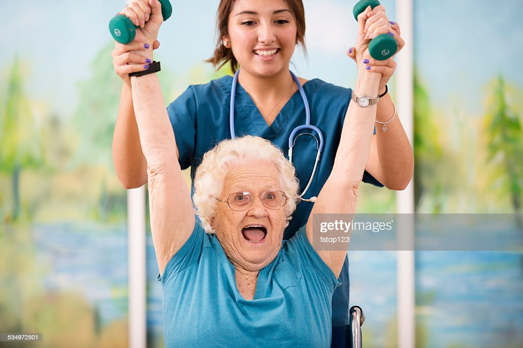 Nurse does physical therapy with senior woman patient. Arm strengthening. : Stock Photo