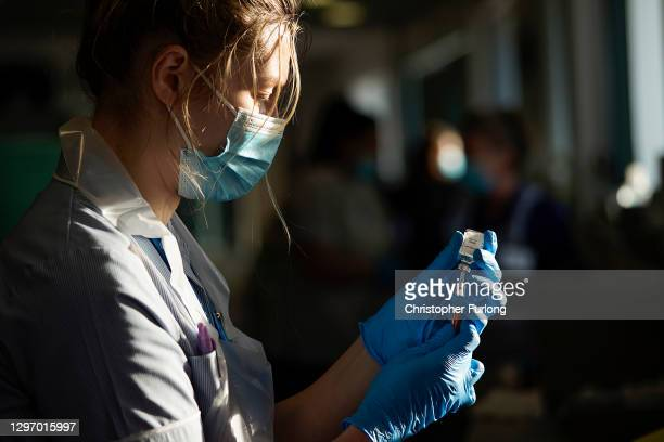 Nurse draws the Oxford-AstraZeneca Covid-19 coronavirus vaccine into a hypodermic needle at Totally Wicked Stadium home of St Helen's rugby club, one...