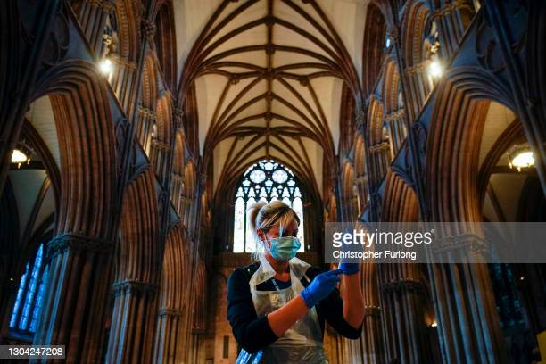 Nurse draws up a vaccine as members of the public receive their Covid-19 vaccinations at Lichfield Cathedral, Staffordshire on February 26, 2021 in...