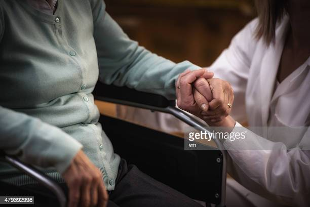 nurse during home visit with senior woman - social services stock pictures, royalty-free photos & images
