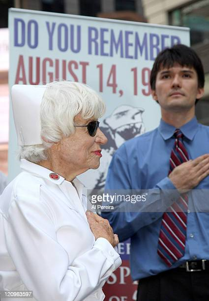 Nurse Edith Shain says a pledge of allegiance before she and Lt Bob Skibar stage a reenactment of Alfred Eisenstaedt's famous Kiss Photo from August...