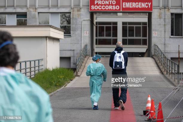 Nurse escorts a man towards the Emergency Room of the local hospital on March 20, 2020 in Cremona, near Milan, Italy. The Italian government...