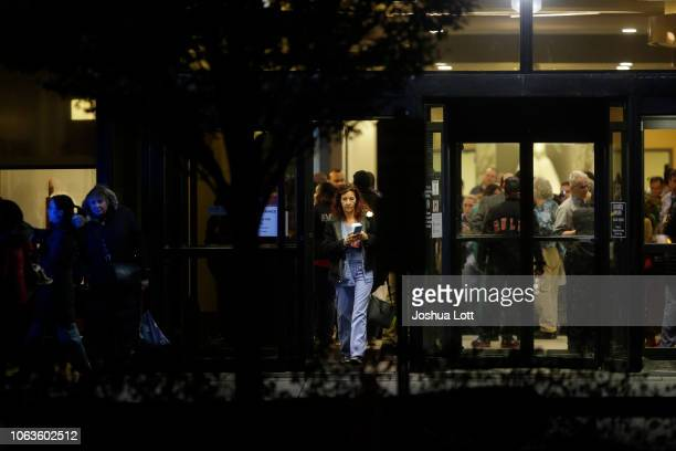 A nurse exits Mercy Hospital after a gunman shot multiple people on November 19 2018 in Chicago Illinois Three people including Chicago police...