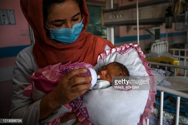Nurse feeds a newborn baby rescued and brought to Ataturk Children hospital, after the mother was killed during a gunmen attack on a maternity...