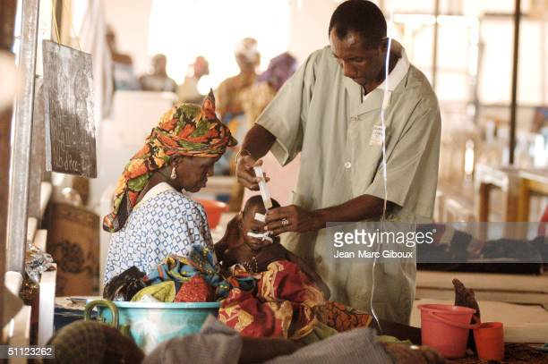 A nurse feeds a severely malnourished child through the nose in the emergency care unit of the Medecinssansfrontieres clinic December 4 2003 in...