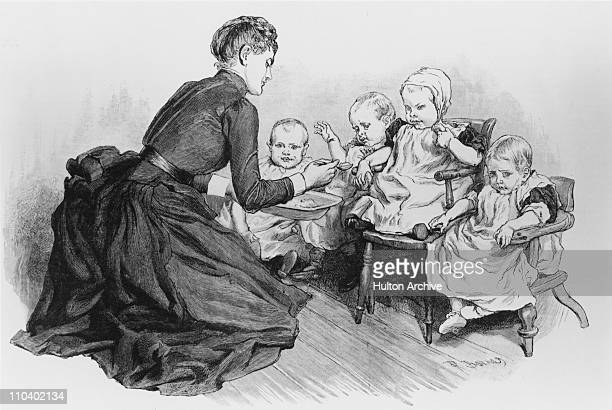 A nurse feeds children in the baby room at a home run by the NSPCC circa 1895 The injured children have been at the home for seven months