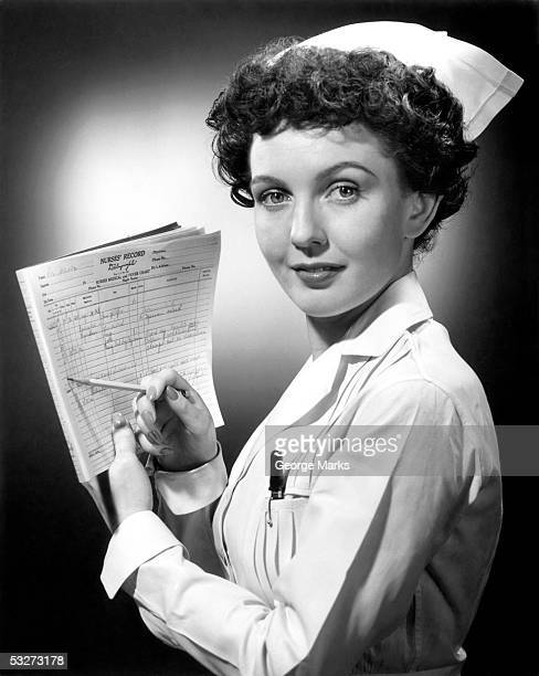 nurse filling out chart - hot nurse stock photos and pictures