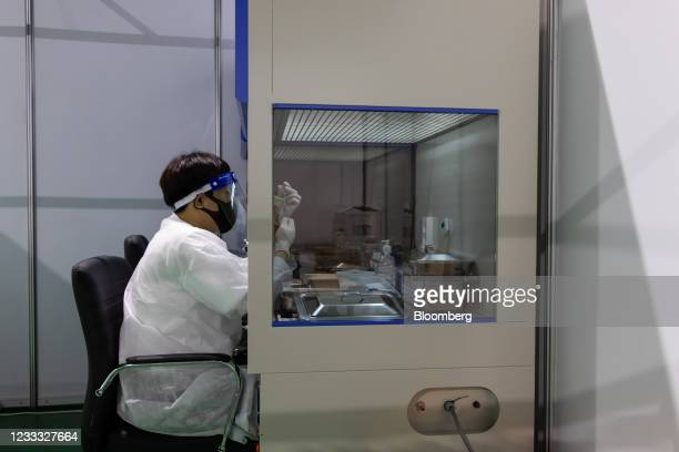 Nurse fills a syringe with a dose of the Pfizer-BioNTech Covid-19 vaccine at a vaccination site inside the Incheon Samsan World Gymnasium in the...