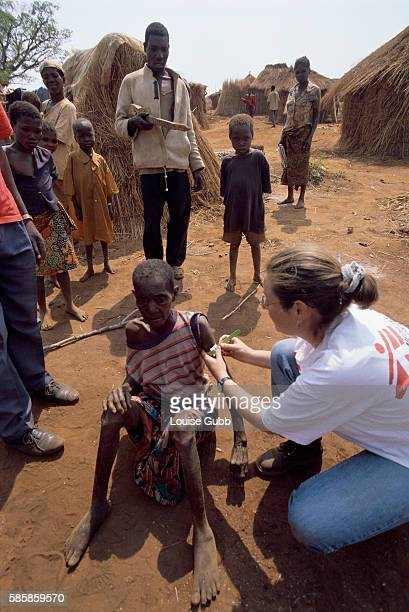 A nurse from Medecins sans Frontieres examines an Angolan villager suffering from malnourishment After Angola gained independence from Portugal in...