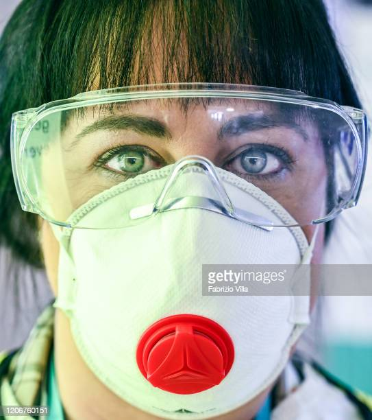 A nurse from the Italian Ministry of Health with a protective mask at Catania airport on March 12 2020 in Catania Italy The Italian government has...
