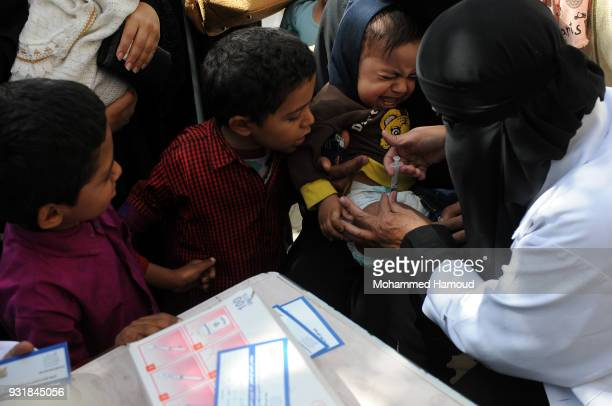 A nurse gives a child a vaccine against diphtheria disease at a health center on March 13 2018 in Sana'a Yemen The World Health Organisation has...