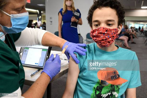Nurse gives Malikai McPherson a shot of the vaccine at a vaccination clinic at Health First Medical Centre. On May 12 the CDC approved the use of the...
