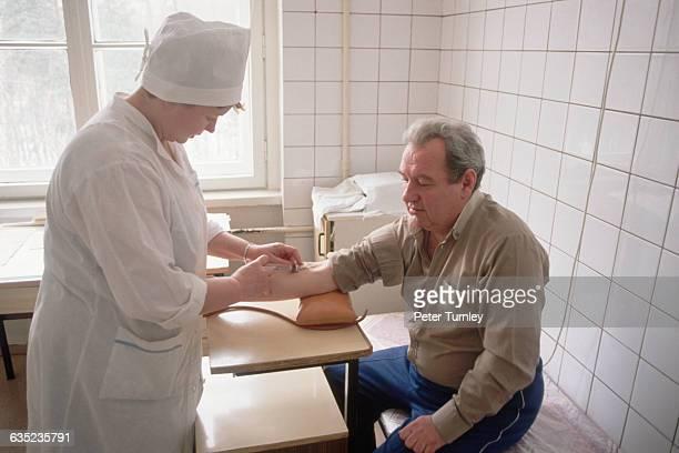 Nurse Giving Psychiatric Patient a Shot