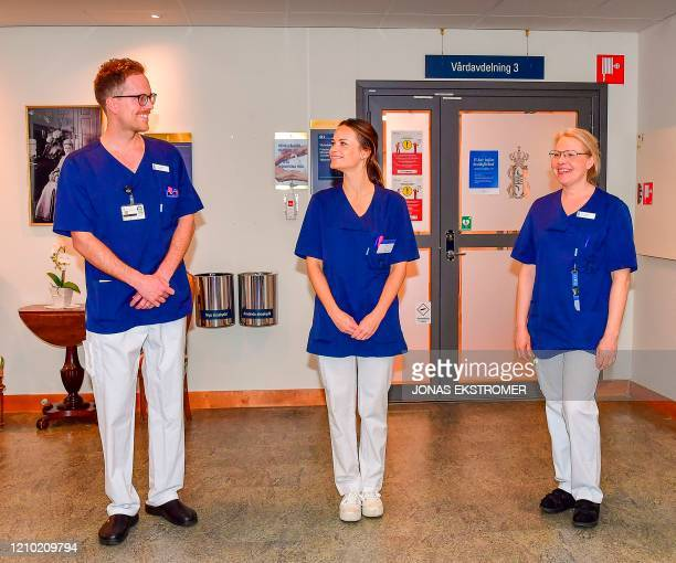 Nurse Gustav Westoo, Princess Sofia of Sweden and assistant nurse Anna Kyhlstedt pose during Princess Sofia's first day at work at the Sophiahemmet...