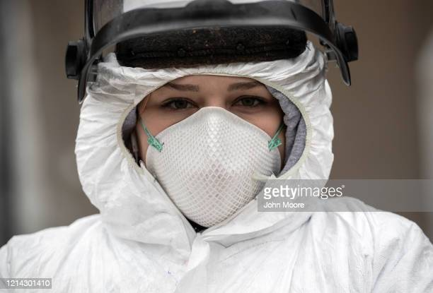 Nurse Hannah Sutherland, dressed in personal protective equipment awaits new patients at a drive-thru coronavirus testing station at Cummings Park on...