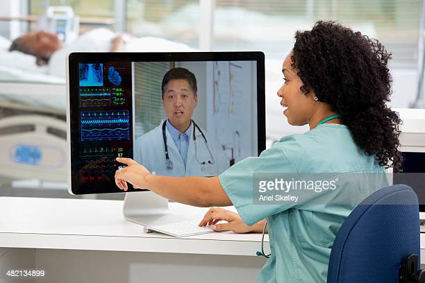 Nurse having teleconference with doctor in hospital