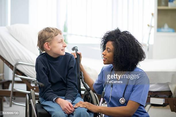 Nurse Helping a Child in a Wheelchair