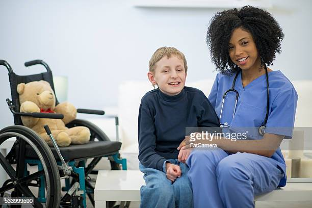 Nurse Helping a Disabled Child