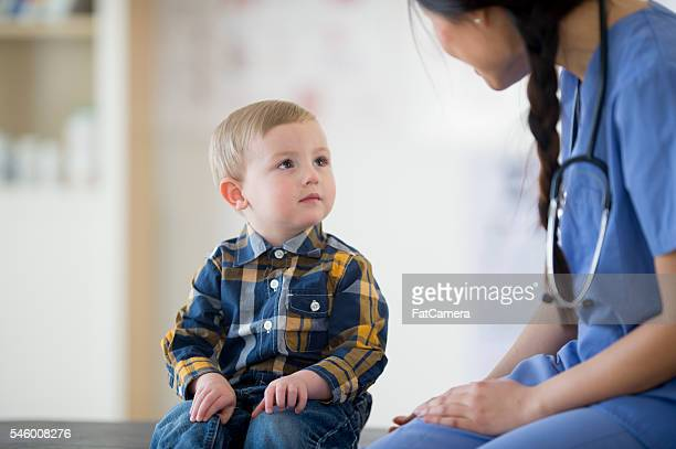 Nurse Helping a Little Boy