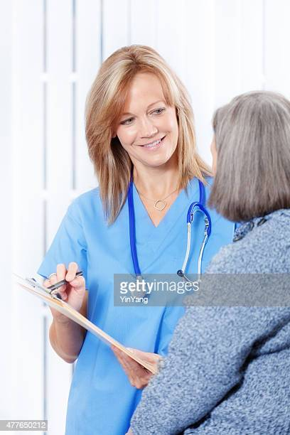 Nurse Helping Senior Patient with Forms and Paper Work