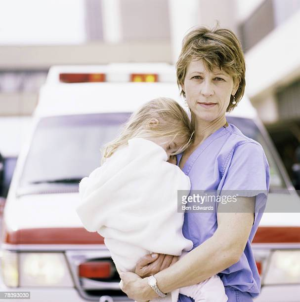 Nurse holding little girl