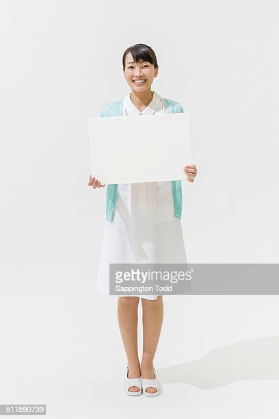 nurse holding placard - nursing slogans stock photos and pictures