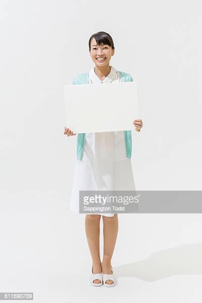 Nurse Holding Placard