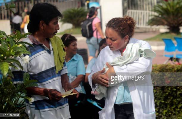 A nurse holds a newborn after evacuating a hospital in Acapulco following a 562magnitude aftershock which was reported minutes after a 60 magnitude...