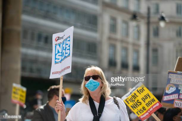 A nurse holds a placard as they demonstrate in front of BBC Broadcasting House in London Britain 12 September 2020 In July the government announced a...