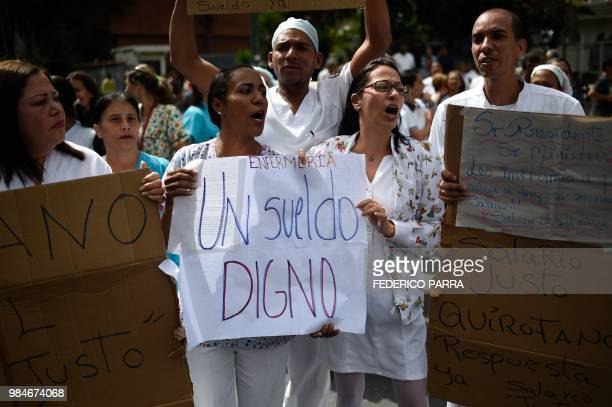 A nurse holds a placard reading Worthy Salary during a protest for the lack of medicines medical supplies and poor conditions in hospitals in Caracas...