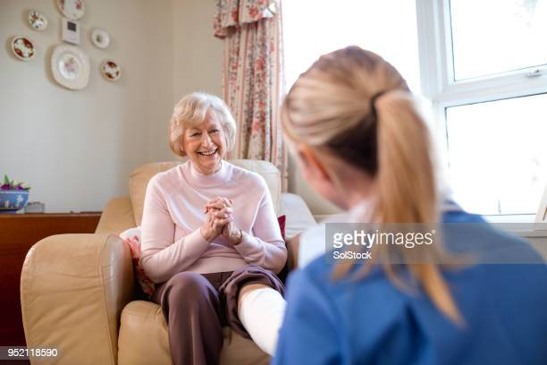 nurse home visit - bandage stock pictures, royalty-free photos & images