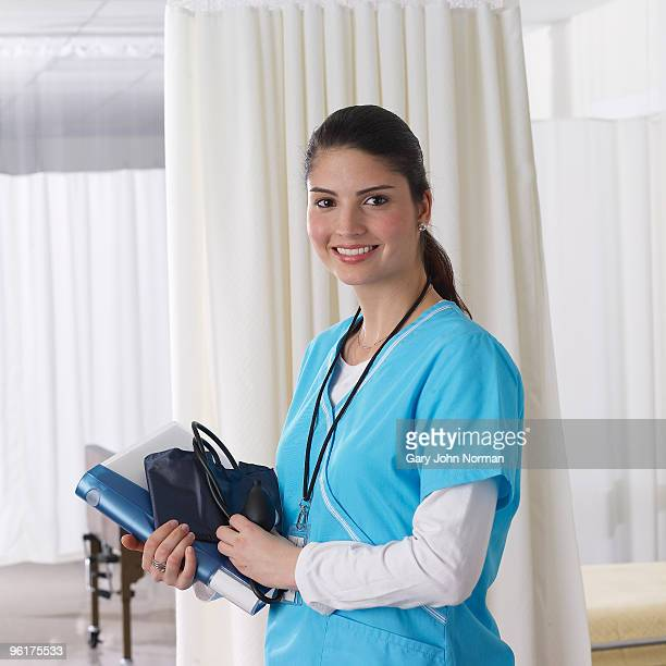 Nurse in ward holding medical notes