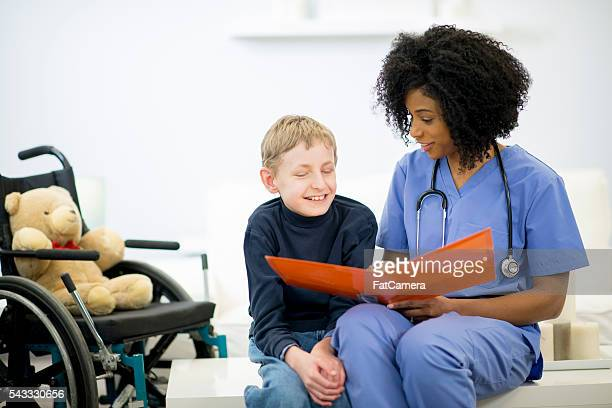 Nurse is Sitting and Reading with a Patient