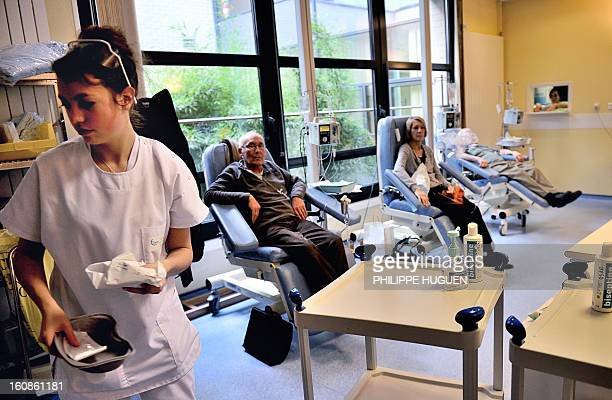 A nurse is working in a room where patients undergo chemotherapy treatment on February 6 at the Oscar Lambret Center in Lille northern France a...