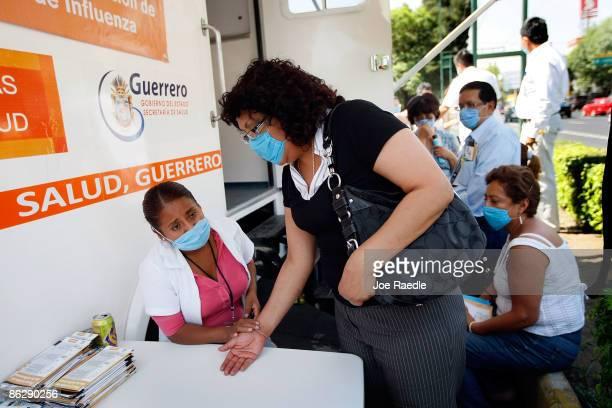 Nurse Ivene Basilio Galeano checks Gloria Briseno at a mobile health clinic after she complained of flulike symptoms on April 29 2009 in Mexico City...