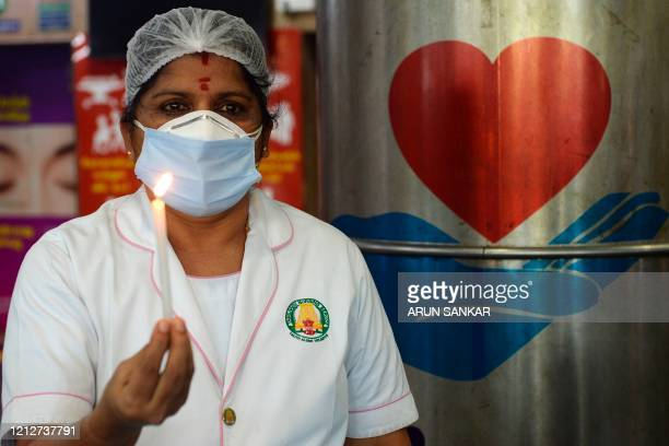 Nurse lights a candle at Rajiv Gandhi hospital in Chennai on May 12 as the world is marking International Nurses Day, celebrated on the birthday of...