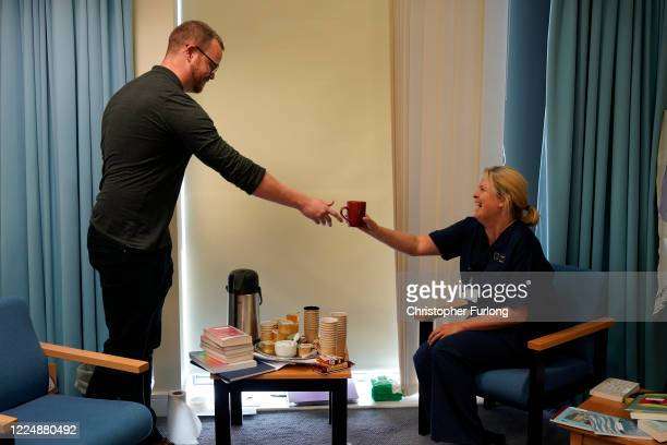 Nurse Linda Brayshay receives a coffee and a smile from psychologist Dr Chris Paterson in the staff wellbeing and support centre where funding from...