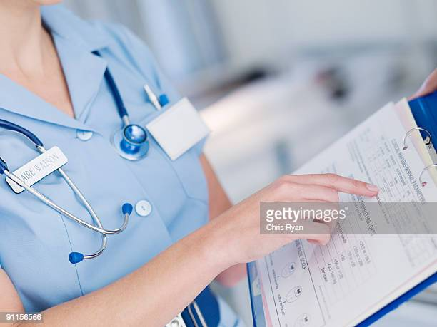 Nurse looking at patientÕs medical chart