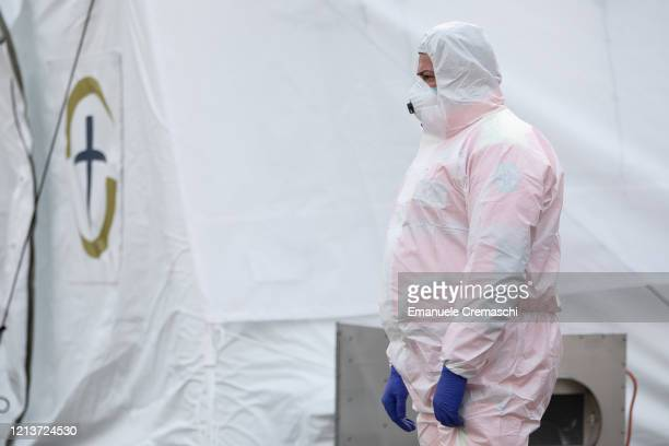 A nurse looks wearing a protective suit looks on at a Samaritan's Purse Emergency Field Hospital on March 20 2020 in Cremona near Milan Italy...