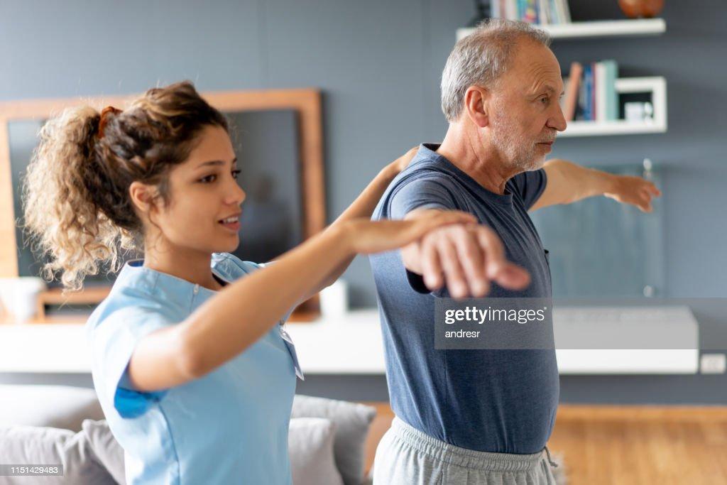 Nurse making a house visit to a senior patient : Stock Photo