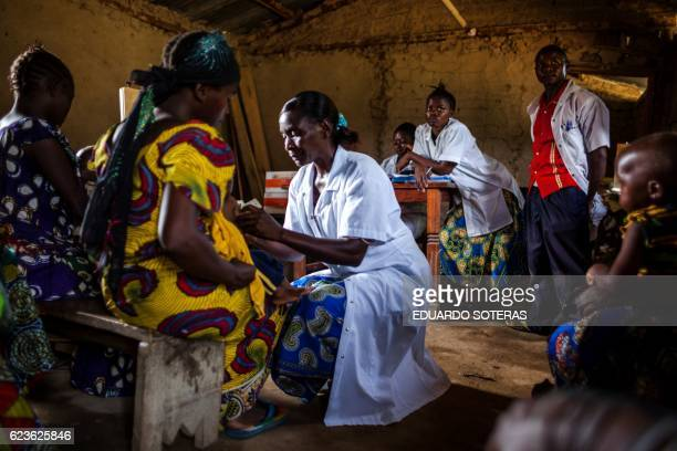 A nurse measures a child as part of a program for malnourished children sponsored by the World Food Program at a Health Center in Mavivi Beni...