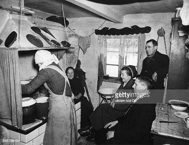 A nurse of the National Welfare Organisation in Nazi Germany is helping in the household of a family of German origin in German occupied Poland