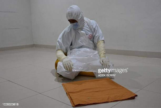 Nurse offers prayers while taking a break from duties taking care of COVID-19 coronavirus patients at the Bogor general hospital in Bogor city, West...