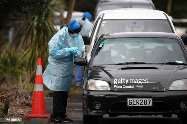 Nurse performs a Covid-19 test on someone in the line at the testing centre at Eden Park on August 14, 2020 in Auckland, New Zealand. COVID-19...